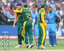 Wayne Parnell is congratulated by Faf du Plessis on the wicket of Shikhar Dhawan, India v South Africa, World Cup 2015, Group B, Melbourne, February 22, 2015