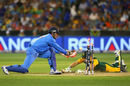 MS Dhoni flicks the ball onto the stumps to run David Miller out, India v South Africa, World Cup 2015, Group B, Melbourne, February 22, 2015