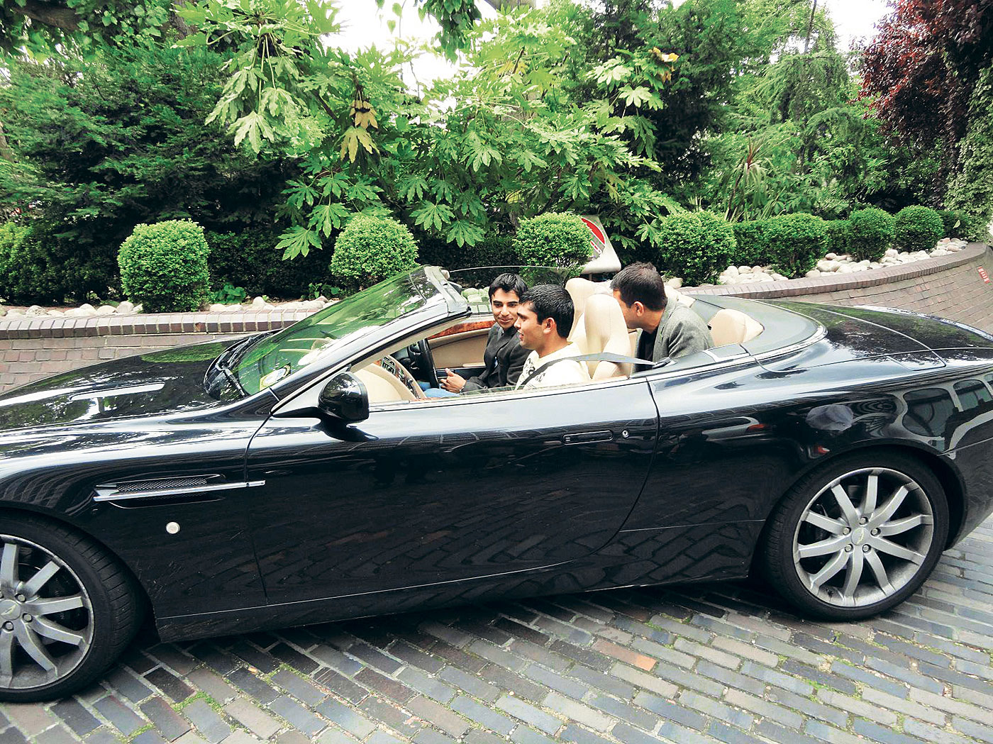 Live fast, fall young: Salman Butt gets behind the wheel of Majeed's Aston Martin in London