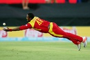 Tinashe Panyangara dives in an attempt to pull off a catch, West Indies v Zimbabwe, World Cup 2015, Group B, Canberra, February 24, 2015