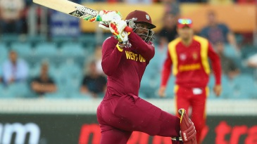 Chris Gayle unleashes a slog sweep