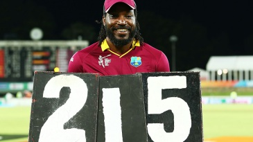 It's all mine: Chris Gayle holds the scoring plates that shout out his record
