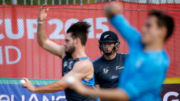 Martin Guptill watches Mitchell McClenaghan during training
