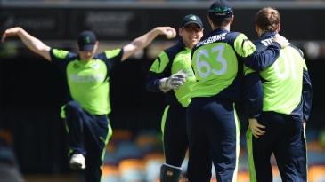Ireland celebrate the wicket of Krishna Chandran