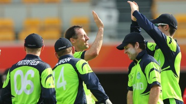 Alex Cusack is congratulated on the wicket of Rohan Mustafa