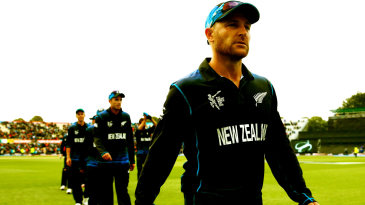 Brendon McCullum leads his players off the field
