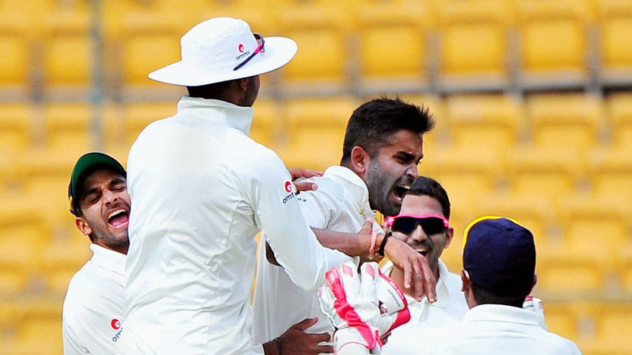 Vinay Kumar is mobbed after taking a wicket