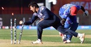 Hamid Hassan makes his ground in time to beat Majid Haq, Afghanistan v Scotland, World Cup 2015, Group A, Dunedin, February 26, 2015
