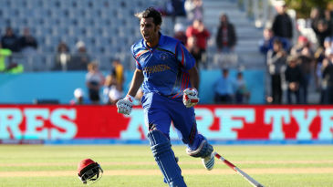 Shapoor Zadran reacts after hitting the winnings runs