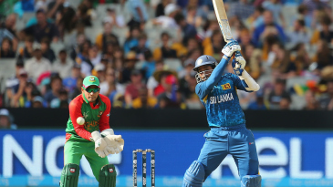 Tillakaratne Dilshan punches the ball on the off side