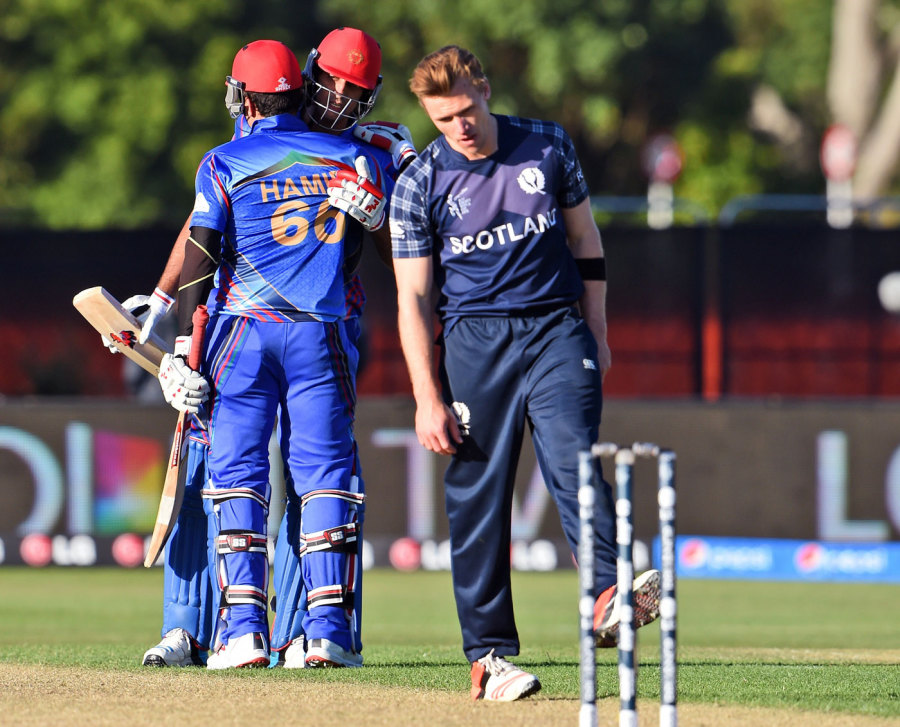 Richie Berrington looks in dejection as Hamid Hassan and Shapoor Zadran celebrate