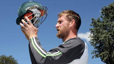 John Mooney displays the homespun neck protection on his helmet