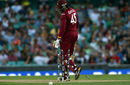 Chris Gayle watches in despair as his leg stump is rattled by a Kyle Abbott delivery, South Africa v West Indies, World Cup 2015, Group B, Sydney, February 27, 2015