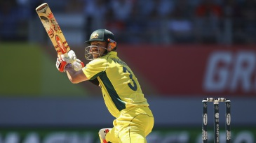 David Warner guides the ball through the off side