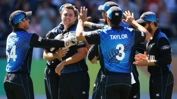 Trent Boult is mobbed after bowling Mitchell Marsh for a duck