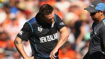 Brendon McCullum examines his arm after taking a hit