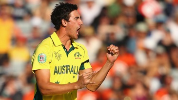 Mitchell Starc roars after taking a wicket