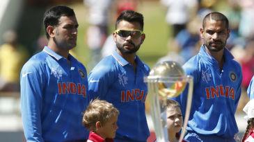 MS Dhoni, Virat Kohli and Shikhar Dhawan before the start of the game