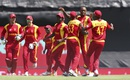 Zimbabwe celebrate after Tendai Chatara removes Nasir Jamshed in the second over, Pakistan v Zimbabwe, World Cup 2015, Group B, Brisbane, March 1, 2015