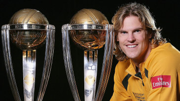 Nathan Bracken poses with the 1999 and 2003 World Cup trophies