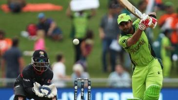 Ahmed Shehzad drives the ball
