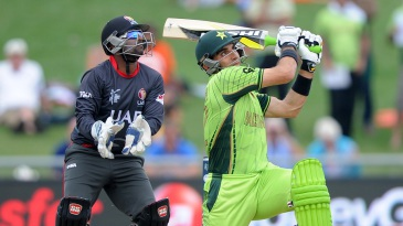 Misbah-ul-Haq hammers a slog sweep on his way to 65
