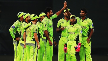Sohail Khan is congratulated on the wicket of Krishna Chandran