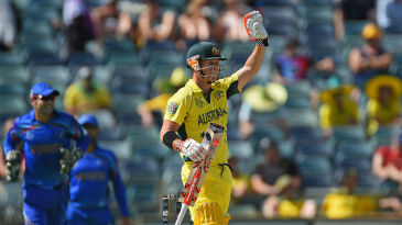 David Warner signals to the dressing room after completing his fifty