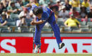 Shapoor Zadran in his follow through, Australia v Afghanistan, World Cup 2015, Group A, Perth, March 4, 2015