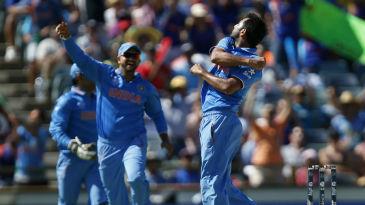 Mohammed Shami celebrates the wicket of Dwayne Smith
