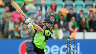Ireland celebrate with the World Cricket League Championship trophy