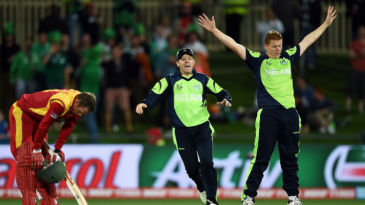 Kevin O'Brien has his hands aloft after having Sean Williams dismissed