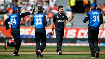 New Zealand gather around Trent Boult after an early wicket
