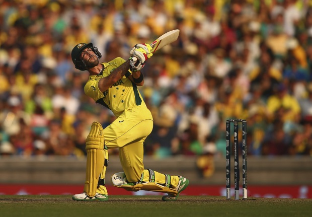 Up, up and away: Glenn Maxwell hoists the ball over the on side
