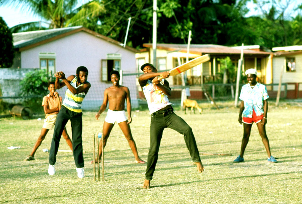 Kids and adults play cricket in Barbados