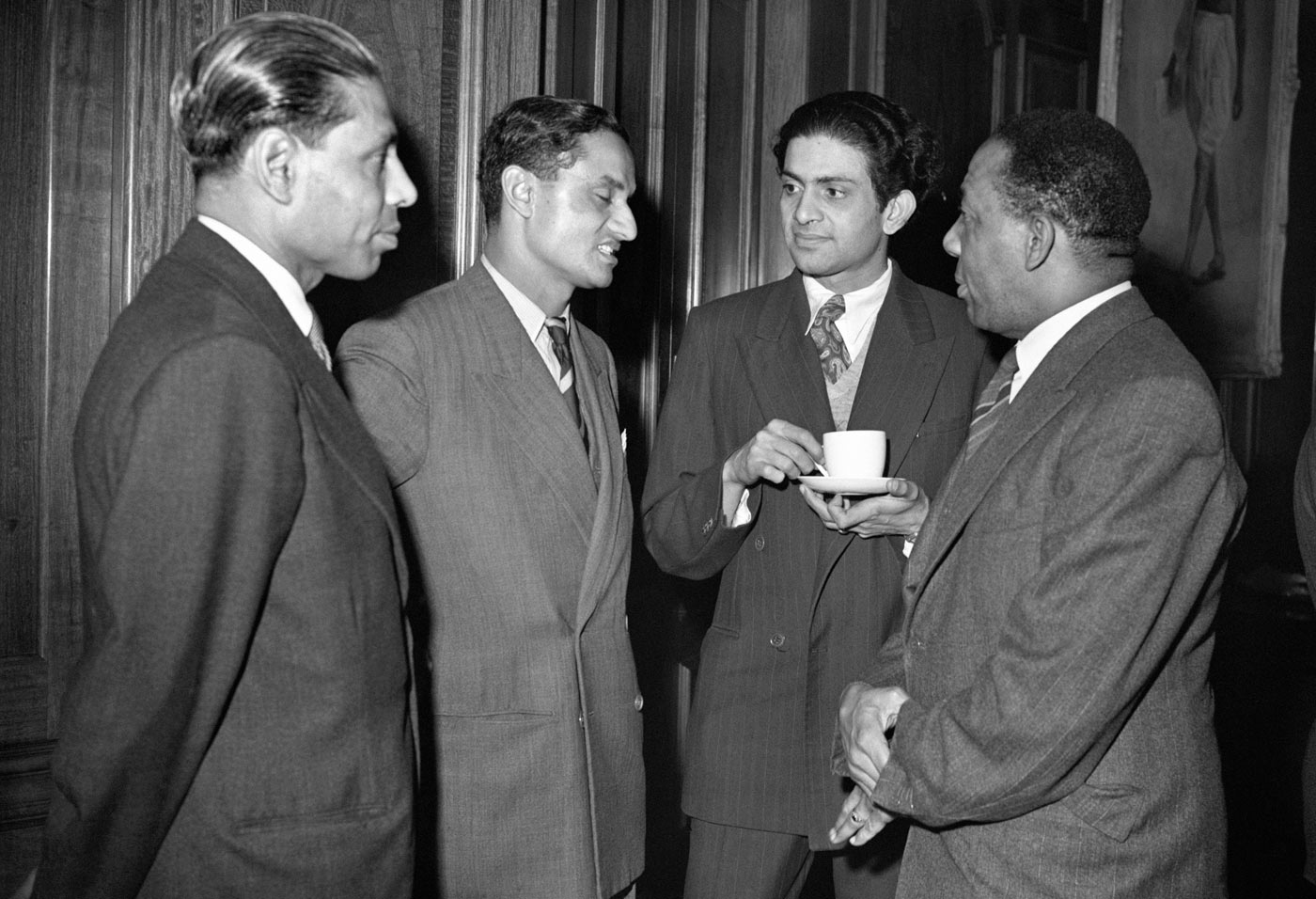 Learie Constantine (right) talks to Vijay Hazare (centre), India's captain on the 1952 tour of England