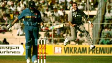Dion Nash celebrates the wicket of Dominic Cork