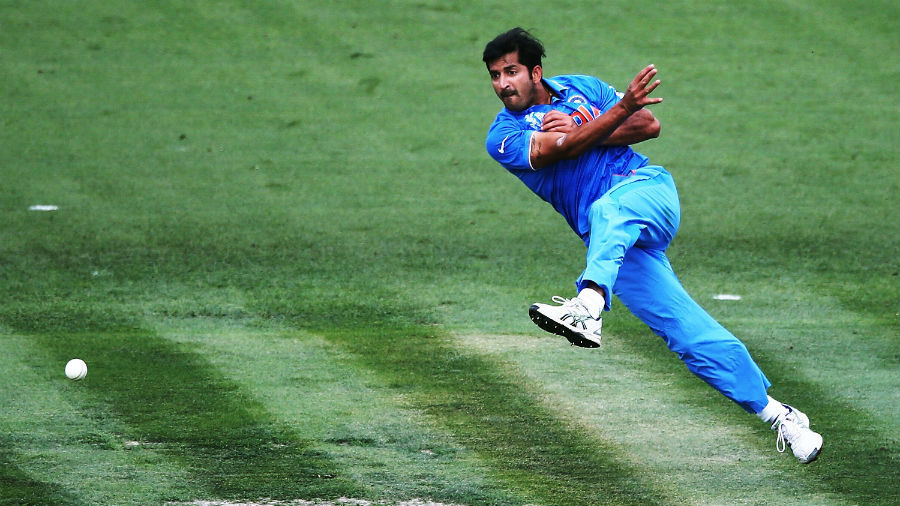 Mohit Sharma goes airborne as he attempts a direct hit