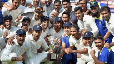 The Karnataka team celebrate their second successive Ranji Trophy title