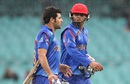 Nasir Jamal and Afsar Zazai walk back after rain interrupted play,  Afghanistan v England, World Cup 2015, Group A, Sydney, March 13, 2015