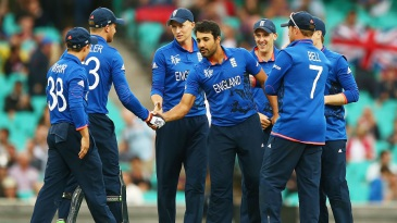 Ravi Bopara is congratulated on striking after the rain break