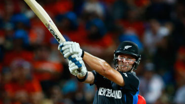 Corey Anderson dispatches the ball over the sightscreen