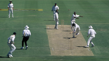 Mark Waugh is about to be run out by Graham Gooch
