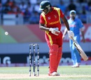 Solomon Mire watches the ball bounce over the stumps after inside-edging it, India v Zimbabwe, World Cup 2015, Group B, Auckland, March 14, 2015