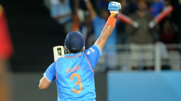 Suresh Raina leaps and punches the air