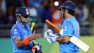 Suresh Raina and MS Dhoni shared an unbroken 196-run stand to lift India to a six-wicket win