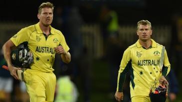 James Faulkner and David Warner walk off after sealing a seven-wicket win