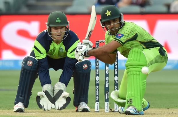 Sarfraz Ahmed prepares to sweep the ball