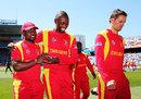 Prosper Utseya, Tendai Chatara and Sean Williams go off the field, India v Zimbabwe, World Cup 2015, Group B, Auckland, March 14, 2015