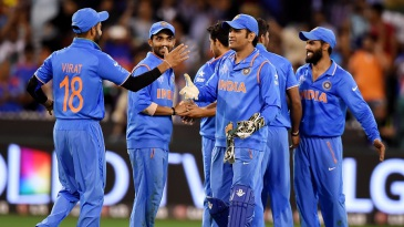 MS Dhoni congratulates his team-mates after sealing the win